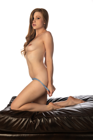 Pretty petite redhead topless in blue gray lingerie