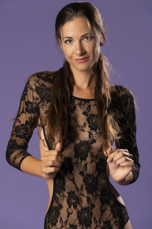 Beautiful tall brunette in a sheer black lace bodysuit Archivio Fotografico - 112455288