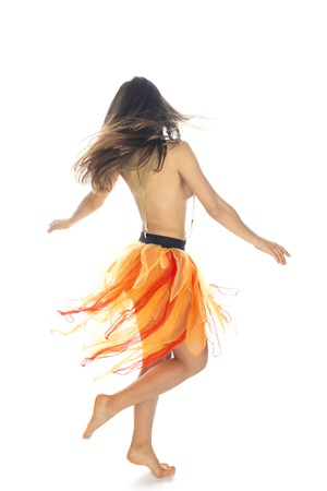 Beautiful slender Romanian brunette topless in an orange tulle skirt