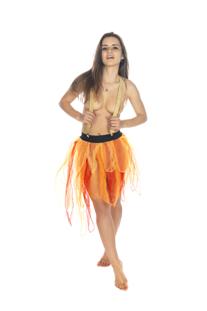 Beautiful slender Romanian brunette topless in an orange tulle skirt Archivio Fotografico - 113381654