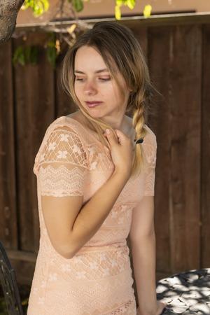 Pretty petite brunette in a peach dress