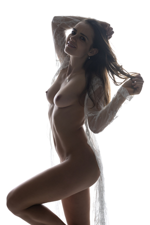Beautiful slender Romanian brunette nude in a white lace wrap