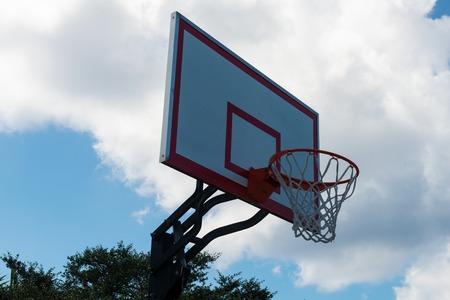 Basketball backboard and hoop against a cloudy sky Stock Photo
