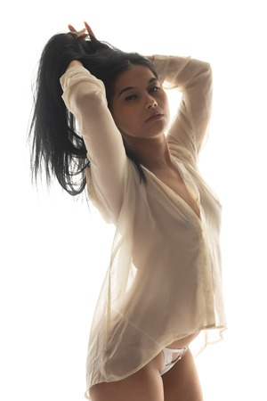 Beautiful petite Filipino woman in a sheer yellow blouse Archivio Fotografico