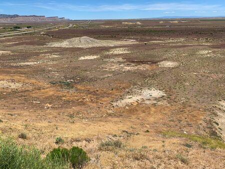 Rolling desert hills and sandstone cliffs, Crescent Junction, Utah