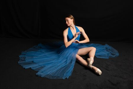 Beautiful young ballet dancer in a blue costume Stock Photo