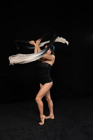 Petite brunette acrobat waving two monochrome banners
