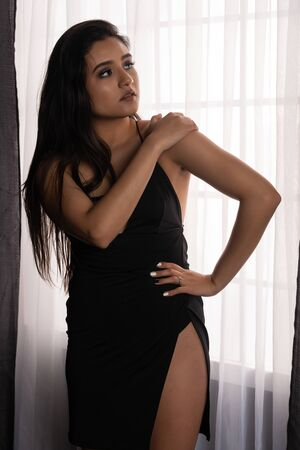 Beautiful young Native American woman in a black dress