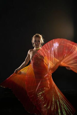 Beautiful slender blonde woman waving bright translucent wings