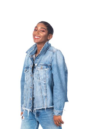 Slender young African American woman in distressed denim