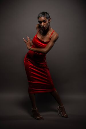 Slender young African American woman in a tight red dress