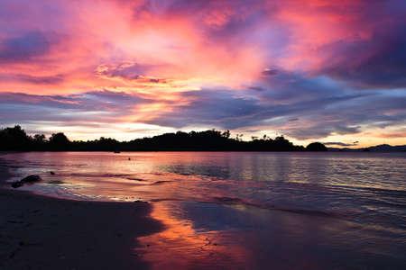 The sun setting down at Aow Khao Kwai (Buffalo bay) at Payam island, Ranong, Thaialnd in October 2011