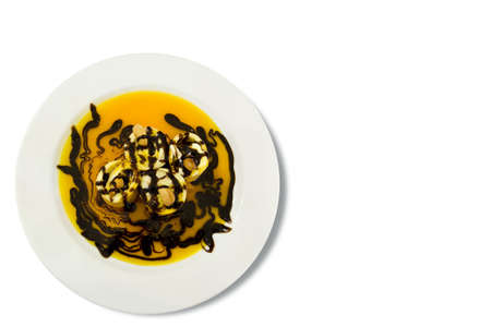 a sweet pancake with cashew nut and chocolate.