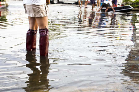Bangkok Thailand 9 November 2011: In flooding situation in Thailand, Thai people wear a long boots to protect them self from disease from dirty water. photo