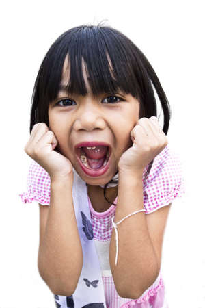 A young pretty girl five years old loosing her teeth and showing her mouth with the missing teeth, for white background. photo