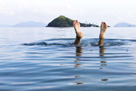 A European man diving underwater  at  Koh Mak, Trat, Thailand  Stock Photo