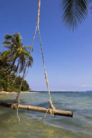 trad: The swing hanging on the coconut tree over the beach at  Trat, Thailand