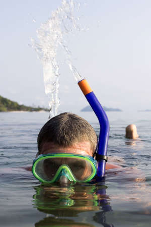 A European man snorkeling blow water on the sea  at  Koh Mak, Trat, Thailand  photo