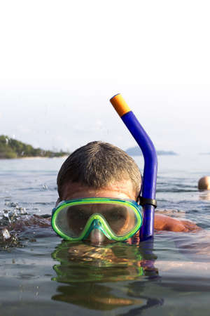A European man snorkeling on the sea at  Koh Mak, Trat, Thailand