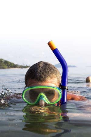A European man snorkeling on the sea at  Koh Mak, Trat, Thailand