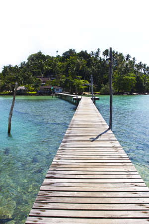 Wooden walking bridge from pier to resort at Koh Mak island, Trat, Thailand Stock Photo