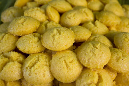 Sugar palm cupcake is a Thai traditional snack  Thai call  Khanon Tan  made from a powder of plam s seed mix with coconut milk and sugar, steam   The yellow color from original plam seed and smell is very tempting  Eat as snack with coffee or tea