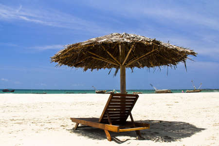 Wooden umbrella with deck-chair at Ngwe Saung, Myanmar photo