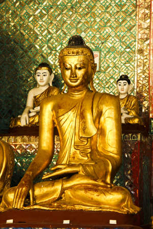 Golden buddha in Shwedagon pagoda Rangon, Myanmar April 2012 photo