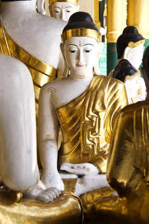 Golden buddha in Shwedagon pagoda Rangon photo