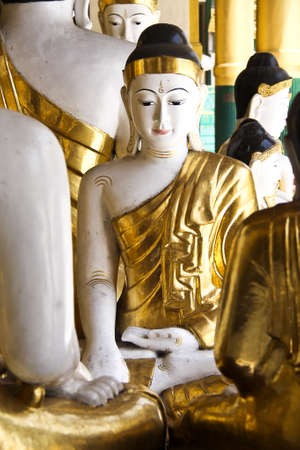 Golden buddha in Shwedagon pagoda Rangon photo