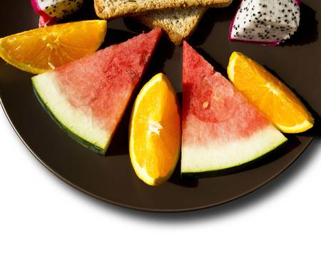 Breakfast with fruits, dragon fruit, orange, watermelon  Stock Photo