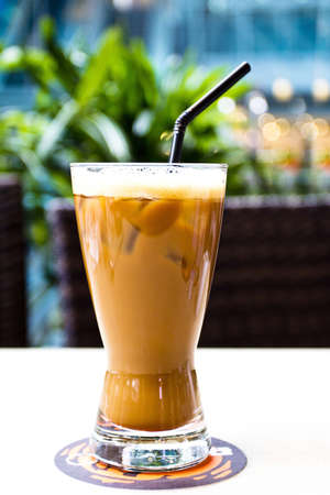 Ice coffee with black straw