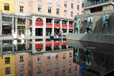 reflection of building on the water at walking street, Norway Editorial
