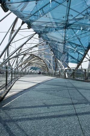 SINGAPORE - 11 October 2012  The Helix Bridge links the Marina Centre   Bayfront areas, completing the 3 5km long walking route around Marina Bay in Singapore