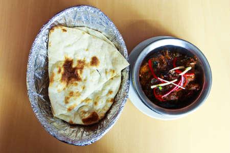 Indian food with curries, rice, naan bread, samosas and pakora