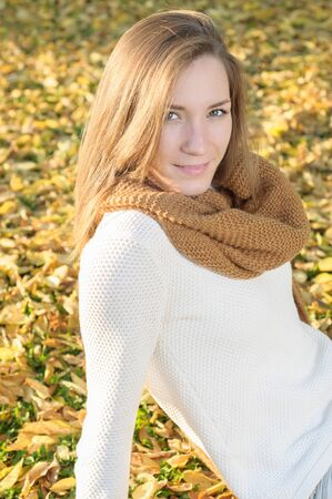 sweater girl: Beautiful young woman portrait, relaxing outdoor in autumn Stock Photo
