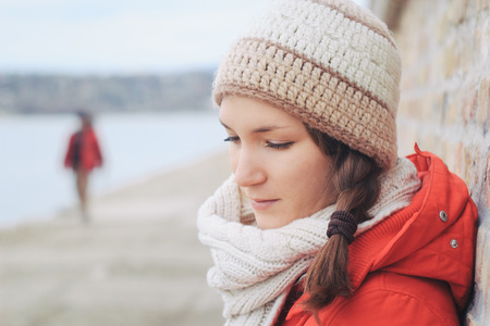 maltreatment: Young thoughtfull woman in winter