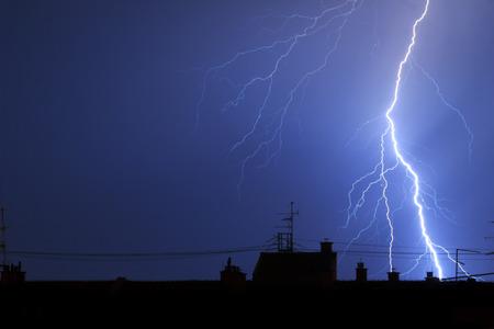 rooftops: Lightning hitting building rooftops in thunderstorm