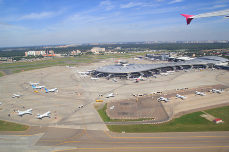 runways: Airport building and airplanes from above Stock Photo