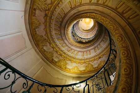 Spiral staircase in old monastery Stock Photo