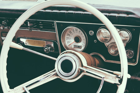 Old timer car steering wheel and dashboard