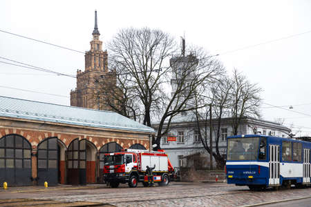RIGA, LATVIA - MARCH 16, 2019: Fire truck is being cleaned - Driver washes firefighter truck at a depo - Scenic view Editöryel