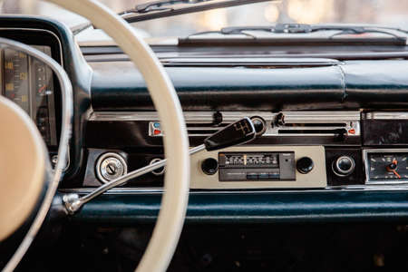 Retro styled image of an old car radio and dashboard inside a classic car Stock Photo
