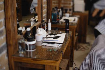 Vintage barber or shaver tools on wooden table in a barbershop