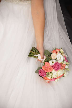 Wedding flowers bouquet in brides hand - Bride in wedding dress