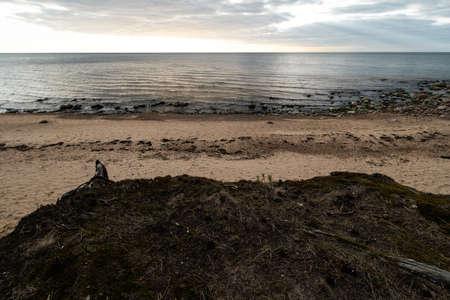 Moss sand and moody cloudy sky on the Baltic Sea close to sunset - Veczemju Klintis, Latvia - April 13, 2019
