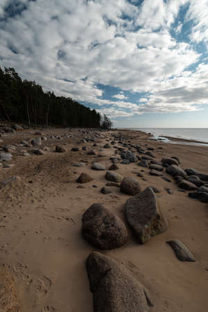 Veczemju Klintis - Boulder beach in Baltic country Latvia - Cloudy sky with dull clouds and a bit of sun