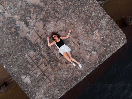 Lonely woman alone - Beautiful aerial Riga port and river Daugava lanscape shots from drone - Top view from above