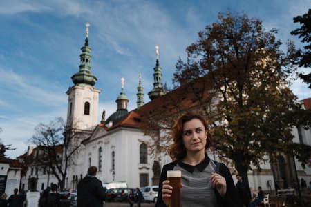 Redhead woman enjoys Strahov Monastery light beer in Prague, Czech Republic