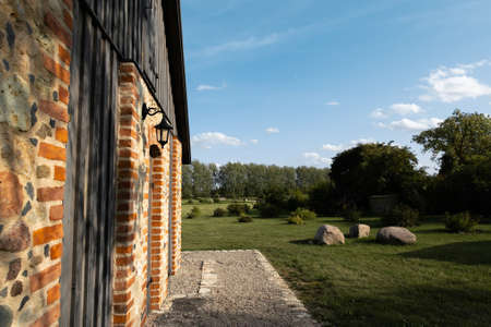 Landscape countryside typical in Eastern European Baltic Mazmezotnes Muiza in Latvia - Brick walls, bridges and hay Stock Photo